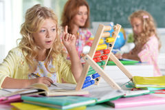 Teacher with two girls at lesson Royalty Free Stock Photography