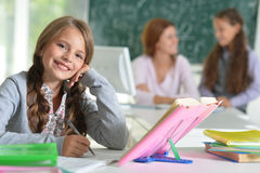 Teacher with two girls at lesson Stock Image