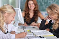 Teacher with two girls Stock Photography