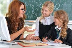 Teacher with two girls Royalty Free Stock Photography
