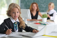 Teacher with two girls Royalty Free Stock Image