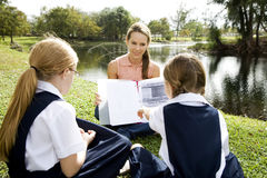 A teacher with two schoolgirls on a school trip Stock Photography