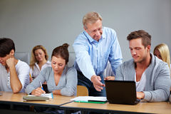 Teacher in university. Talking to his students Royalty Free Stock Photography