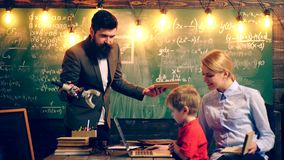 The teacher urges the boy to study. Learning concept. School children in uniform. Teacher in classroom. Teacher and. Student. Back to school stock video