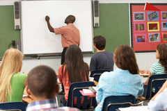 Teacher Using Interactive Whiteboard During Lesson Stock Photography