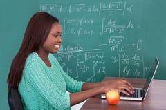 Teacher Using Laptop At Classroom Royalty Free Stock Photos