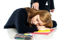 Teacher waking up a dozed off student Royalty Free Stock Photo