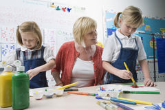 Teacher Watching Students Paint Stock Images