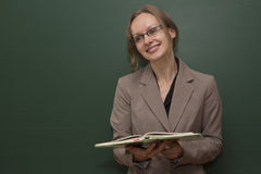 Teacher is welcoming the class. Young smiling teacher is welcoming student royalty free stock images