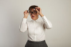 Teacher in white blouse with 3 pairs of glasses stock photography