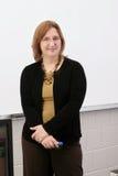 Teacher at the white board Stock Photo