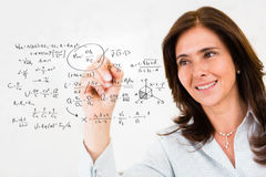 Teacher wiriting formulas Stock Photography