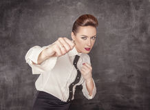 Teacher woman beating with her fists Stock Image