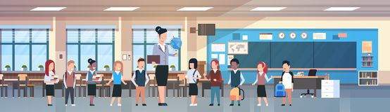 Teacher Woman With Group Of Mix Race Students In Classroom, Diverse Pupils In Modern Class Room In School. Flat Vector Illustration Stock Image