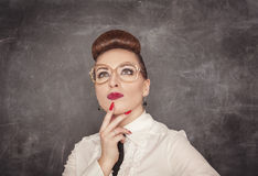 Teacher woman looking up above on the blackboard background Royalty Free Stock Photography