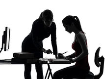 Teacher woman mother teenager girl studying silhouette Stock Images