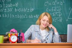 Teacher woman sit table chalkboard background. Excellent communicability and interpersonal skills. Well organized and. Committed teacher. Organize class and stock photos