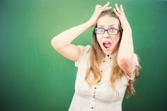 Teacher woman in stress or depression at school classroom royalty free stock photography