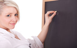 Teacher woman writing on blackboard Royalty Free Stock Photos