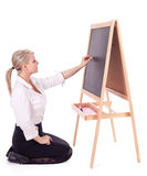 Teacher woman writing on blackboard Stock Photos