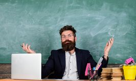 Teacher wondered low level of knowledge. What stupid thought. Man bearded teacher wondering expression sit classroom. Chalkboard background. What are you stock photography