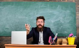 Teacher wondered low level of knowledge. What are you talking about. Unpleasant wonder. What stupid thought. Man bearded. Teacher wondering expression sit stock image