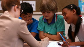 Teacher working with her pupils stock footage