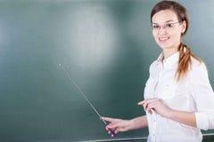 Teacher working next to blackboard Stock Photos