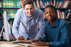 Teacher Working With Pupil At Computer Stock Photography