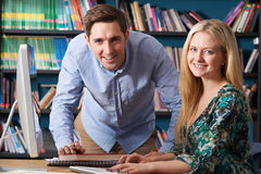 Teacher Working With Teenage Pupil At Computer. Teacher Works With Teenage Pupil At Computer Stock Photo