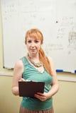 Teacher writes on blackboard Stock Photos