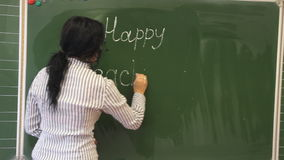 Teacher writes Happy Teacher`s Day stock footage