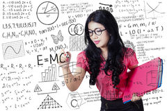 Teacher writes maths and science formula Royalty Free Stock Image