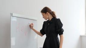 Teacher writes a word about help