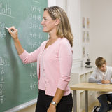 Teacher writing on blackboard Stock Photos
