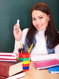 Teacher writing on blackboard. Royalty Free Stock Image