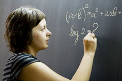 Teacher writing on blackboard Royalty Free Stock Images