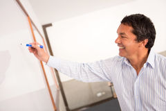 Teacher writing on the board Stock Photography