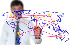 Teacher writing Currency  connection on world map Stock Image