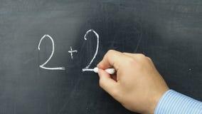 Teacher writing incorrect equation blackboard chalkboard stock footage