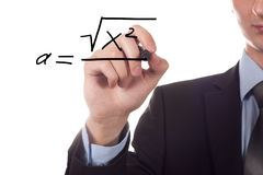 Teacher writing a mathematical equation. Isolated on white background. Focus is on his hand and pen Stock Images