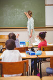 Teacher writing mathematics on board Royalty Free Stock Photography