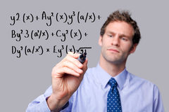 Teacher writing a maths equation. Royalty Free Stock Photo
