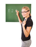 Teacher writting on chalkboard Royalty Free Stock Images