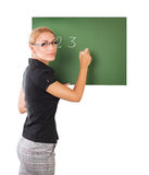 Teacher writting on chalkboard Stock Photos