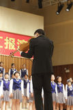 Teacher xuxin is well-known violinist. while play the violin, while conduct Royalty Free Stock Images
