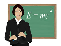 Teacher. A young teacher in a business suit on the background of the school Board with the inscription of the law of physics royalty free stock image
