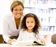 Teacher with a young student Stock Photo