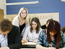 Teacher and young students Stock Photography