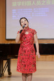 Teacher zhangzhaoying of xiamen university od technology singing song. The evening of 25 october 2014, xiamen city, china. oversea returnees held a concert in royalty free stock image